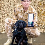 London, Imperial War Museum, 24 February 2010 - A good day to be a dog. Hero dog receives animals' Victoria Cross for action in Afghanistan. Black Labrador, Treo, is presented with the PDSA Dickin Medal (the animals' VC) for saving the lives of many soldiers, when he detected IED's hidden by the Taliban in Afghanistan. Photo: Nathanael Corre.
