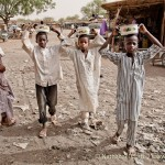 Boys carrying food in Dakoro, Niger. May 2010.